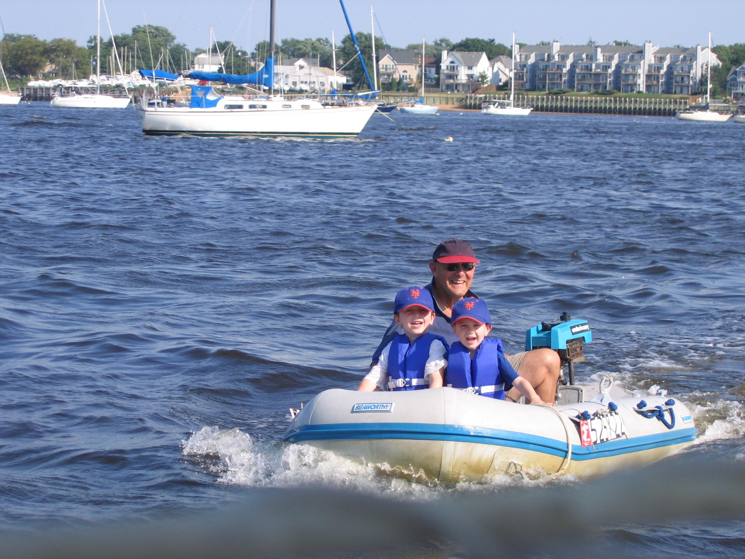 Charlie Ezra and Zeke in the Windbairn Dinghy